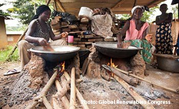 African women cooking with wood
