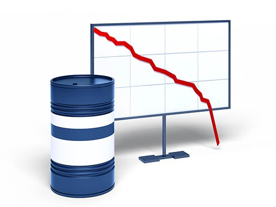 Oil barrel next to graphic showing falling prices off the chart
