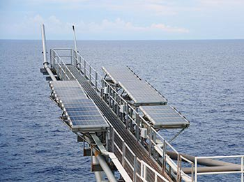 Solar panels generate energy on an offshore facility